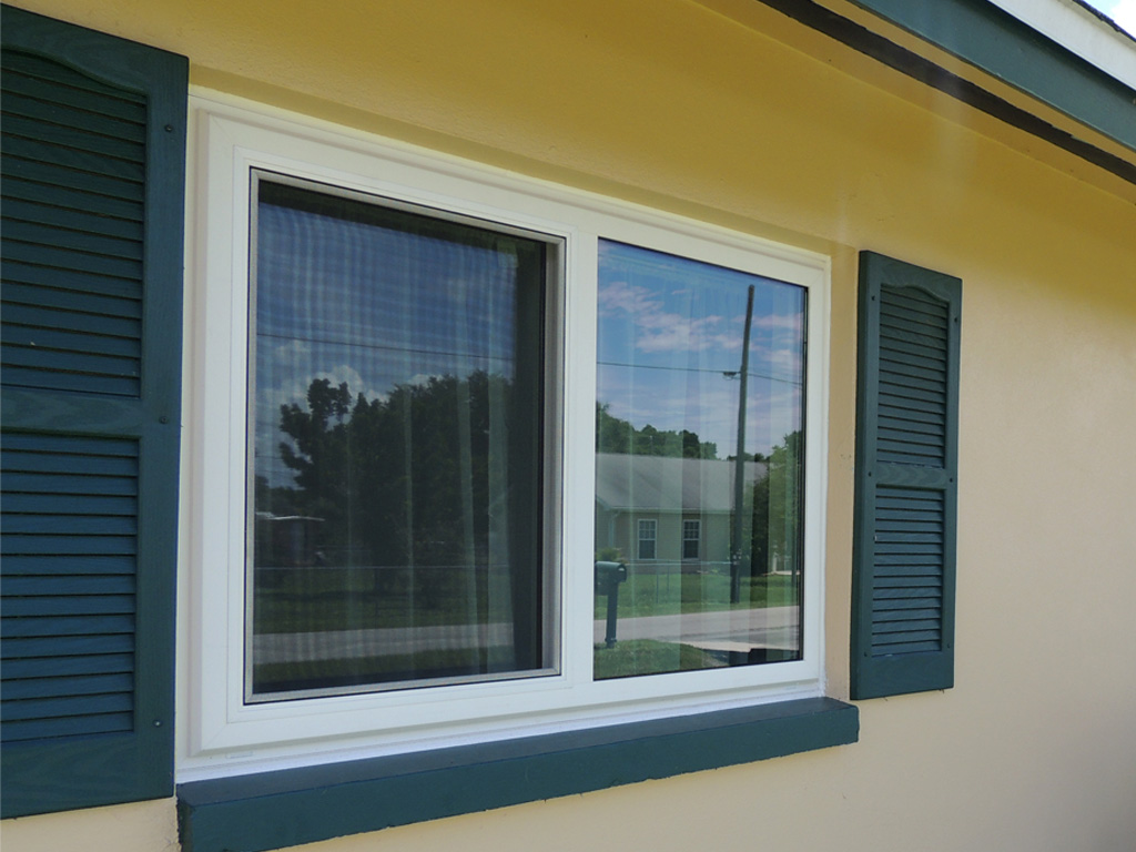 Horizontal slider window storm shield for Sliding window