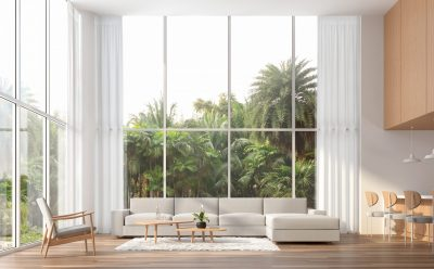 Interior view of large picture windows in a modern living room