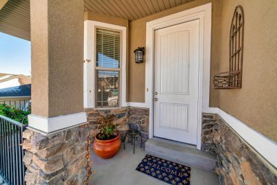 Small single-hung window adjacent to clean white entry door